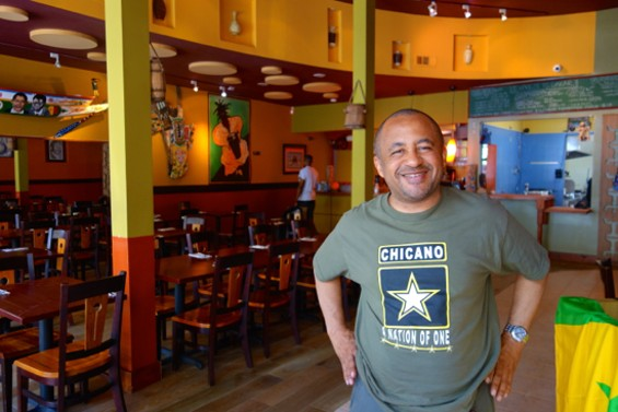 Bissap Baobab owner, Marco Senghor at the new Oakland location. - FERRON SALNIKER