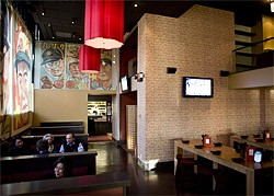JEN SISKA - Blown-up images of Japanese baseball cards adorn the walls of O Izakaya at the Hotel Kabuki.