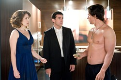 Boring couple meets shirtless security expert: Fey, Carell, and Wahlberg.