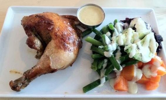 Brasa's pollo a la brasa with vegetable salad. - JONATHAN KAUFFMAN
