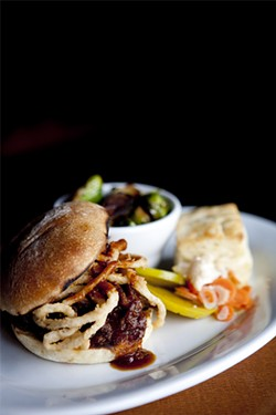 JEN SISKA - Brisket with onion rings and pickled green tomatoes on a house-made bun.
