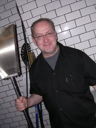 "Bruce Hill, going all ""American Gothic"" with the pizza shovel. - JOHN BIRDSALL"