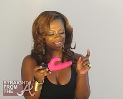 Burruss shows off her Happiness & Joy toy. - STRAIGHTFROMTHEA.COM