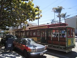 Cable cars zoom down Taylor Street en route to the Warf.