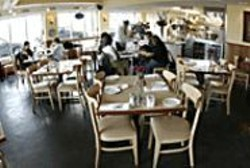 JAMES  SANDERS - Café Bella Vista's modestly decorated - dining room belies the excellent Spanish - fare.