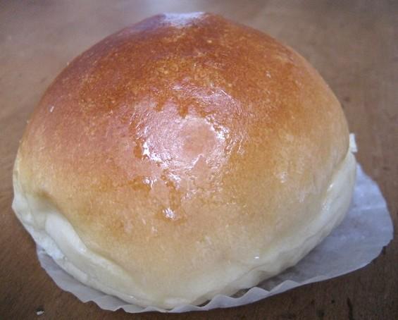 Cafe Bakery's baked BBQ pork bun, $1. - JONATHAN KAUFFMAN