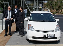 AP PHOTO/ERIC RISBERG - California Gov. Jerry Brown, State Sen. Alex Padilla, and Google co-founder Sergey Brin got driven to Google HQ by a robot.