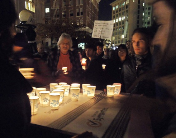 Candles are distributed at last night's general assembly - KATE CONGER