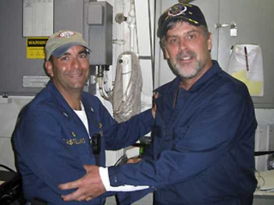 Capt. Richard Phillips, right, shakes hands with Lt. Cmdr. David Fowler, executive officer of USS Bainbridge, shortly after his rescue - U.S. NAVY