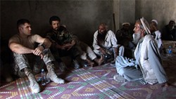 Captain Dan Kearney (far left) meets with local Afghan elders.