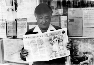 Cesar Chavez reading a copy of El Tecolote - ACCION LATINA