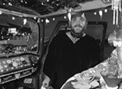 PAOLO  VESCIA - Charlie Russell's mobile cocktail lounge doubles as - his home.