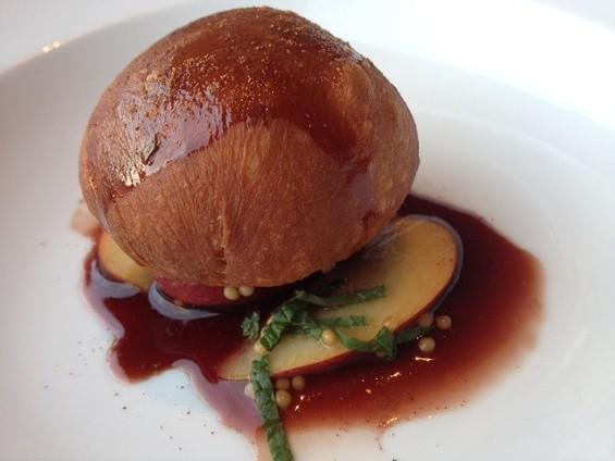 Chaya Brasserie's foie gras beignet in cinnamon-port wine reduction. - TAMARA PALMER