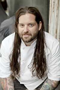 Chef Adam Hinojosa and his luscious, soon-to-be-donated locks. - WENDY HECTOR
