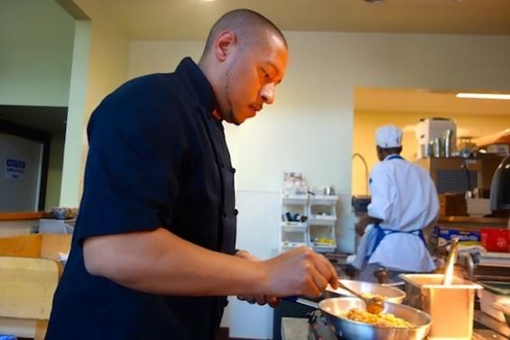 Chef Nelson German at work in the alaMar kitchen. - FERRON SALNIKER