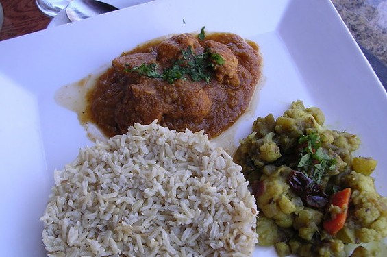 Chicken korma, vegetables cooked with coconut sauce, and brown rice ($13.95 as part of a three-course menu). - JOHN BIRDSALL