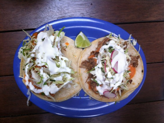 Cholita Linda's Baja fish taco (left) and carnitas (right) are both excellent. - MOLLY GORE