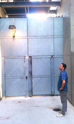 JOE ESKENAZI - Chris Costedio is left to wonder how his bike disappeared from behind this mighty door.