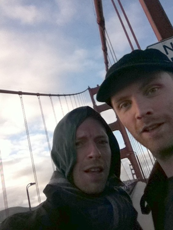 Chris Martin and guitarist Johnny Buckland taking the ultimate tourist pose