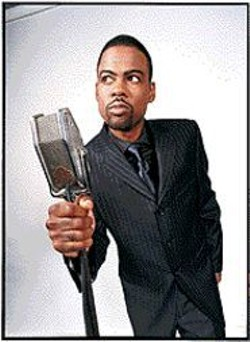 Chris Rock with the only tool he needs to - make comedy magic.