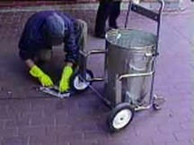 "Chris Sollars cleaning trash in the street, from his art project ""Street Clean"""