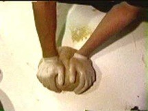 """Chris Sollars making bread with gloves, from his art project """"Making Bread"""""""