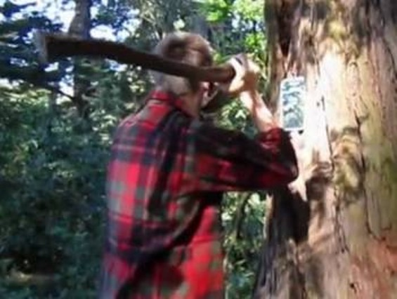 """Chris Sollars shaving himself with an axe, from his art project """"Hairy"""""""
