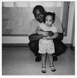 Christopher Taylor (with his niece) was represented by a lawyer who was suspended from practicing during Taylor's robbery trial.
