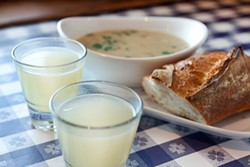 LARA HATA - Clam juice, clam chowder, and sourdough: The start of a meal at the Old Clam House.