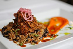 ANNA LATINO - Classic Cuban ropa vieja gets gussied up with rioja-sofrito jus, smoked corn puree, beet gastrique, and black beans and rice.