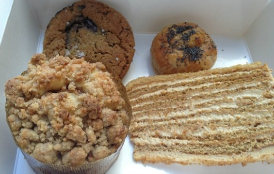 Clockwise from top left: Chocolate chip cookie, potato knish, Russian honey cake, raspberry-plum coffee cake from 20th Century Cafe. - ANNA ROTH