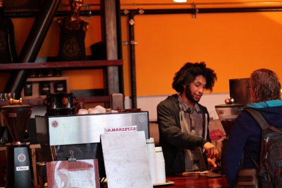 Co-owner Payam Imani pouring drinks in Alchemy's expanded location. - MOLLY GORE