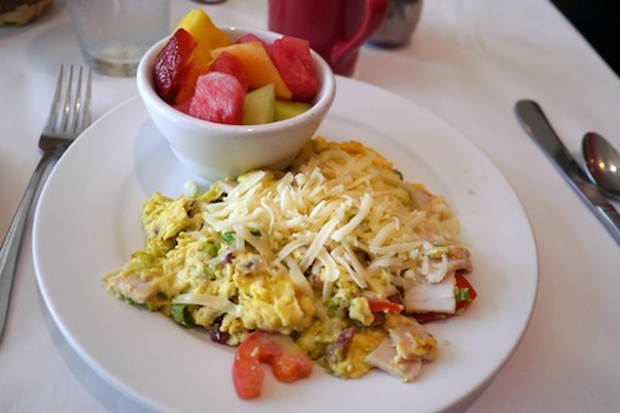 Cobb scramble with turkey, bacon, tomatoes, avocado and shredded Swiss cheese