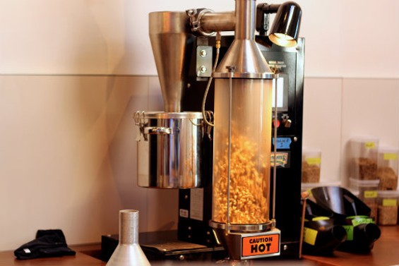 Coffee popping around in the Java Master, a hot air roaster. - MOLLY GORE