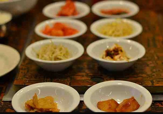 Complimentary banchan at New Korea House. - MISSY BUCHANAN