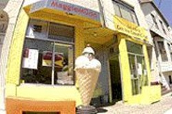 ANTHONY  PIDGEON - Cool Comfort: The new Maggie - Mudd is the very model of a modern - ice cream parlor.