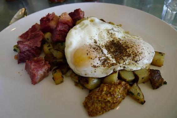 Corned beef hash with house-made mustard and fried eggs