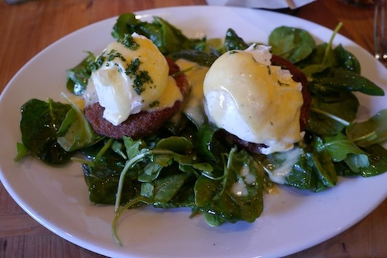 Crab-and-Artichoke Cakes, with poached eggs, hollandaise, spinach, and bacon
