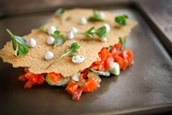 LARA HATA - Cracker covers salmon tartare and cucumbers.