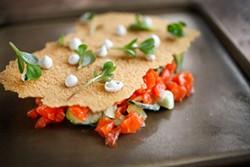 LARA HATA - Cracker covers salmon tartare and cucumbers.