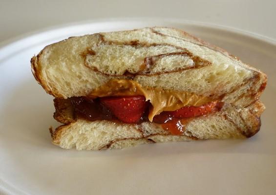 Creamy peanut butter, raspberry jelly, and strawberries on cinnamon challah, $1.50. - ALEX HOCHMAN