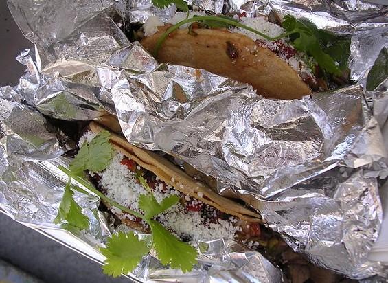 Crispy tacos with bacon al pastor and carnitas ($3 each). - JOHN BIRDSALL