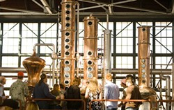 FLICKR/CHARLES HAYNES - Customers on a tour at St. George Spirits.