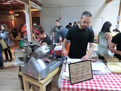 ALEX HOCHMAN - Dan Jablow puts his stamp on smoked meat at a recent Underground Market.