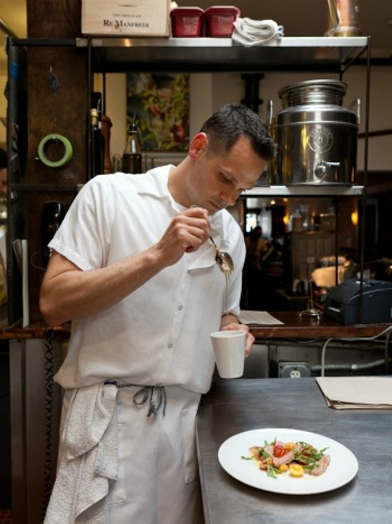 David Taylor puts the finishing touch on a dish - ALANNA HALE