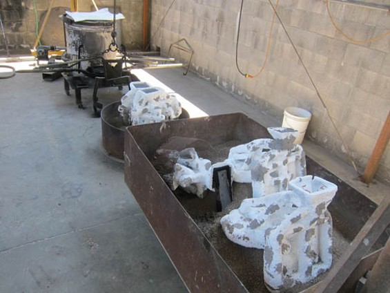 De-kilned molds await bronze casting.