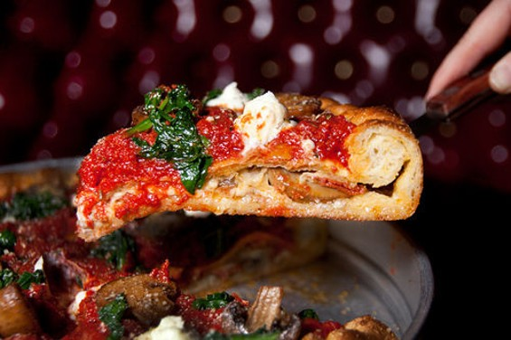 Deep-dish pizza at Capo's, reviewed this week, is definitely an indulgence. - LARA HATA