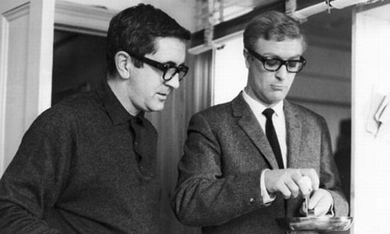 Deighton shows Michael Caine how to crack an egg on the set of The IPCRESS File - THE RONALD GRANT ARCHIVE