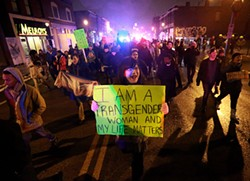 AP PHOTO/ST. LOUIS POST-DISPATCH, CHRISTIAN GOODEN - Demonstrators over the grand jury decision in the Michael Brown case march with LGBT activists in St. Louis.