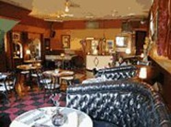 ANTHONY  PIDGEON - Dine-One-One: The revamped Il Pirata looks like an - Eisenhower-era diner reimagined by the Merry - Pranksters.